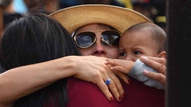Ramona Vargas of Mexico hugs her daughter, Delia Valdovinos-Sanchez and her grandson, Richardo Imani Gonzalez. Photo by Chris Stone