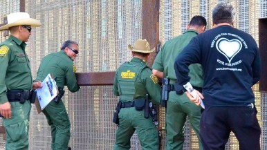 Border patrol agents open the border fence for the fourth time in cooperation with Border Angels. Photo by Chris Stone