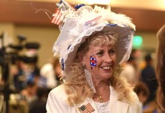 Deborah Boyd of Poway wears her handmade hat with a White House on top at Westin Hotel gathering of Democrats. Photo by Chris Stone