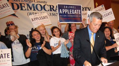 Democrat Doug Applegate prepares to speak to supporters at the Westin Hotel. Photo by Ken Stone