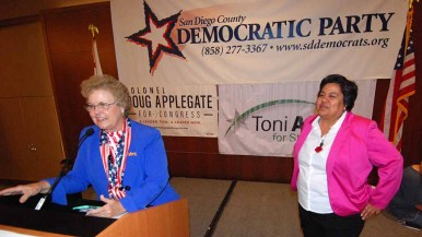 District 9 San Diego City Council candidate Georgette Gomez is introduced to Democrats by county chairwoman Francine Busby. Photo by Ken Stone