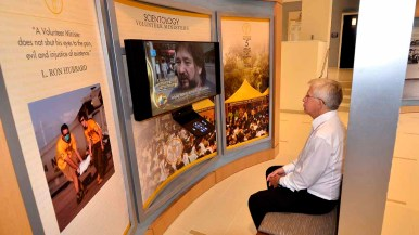 Videos devoted to Scientology volunteer ministers are viewed in first-floor Information Center. Photo by Ken Stone