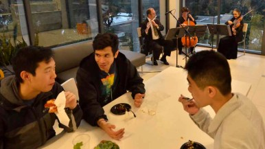 Students dine near opening day music accompaniment by Caprice Strings. Photo by Chris Stone