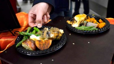 Free samples of chicken, potatoes and other vegetables were offered at UCSD restaurant's debut. Photo by Chris Stone