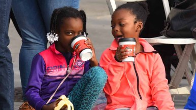 Young girls enjoy a drink and snack during the two-hour parade. Photo by Chris Stone