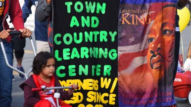The Town and County Learning Center carried its colorful banner in the the annual Martin Luther King Parade. Photo by Chris Stone