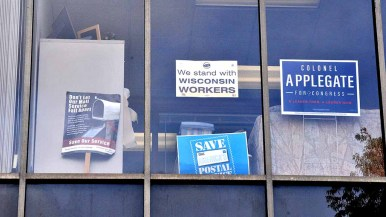 Union and Democratic-themed signs decorate upstairs windows at United Labor Center in Mission Valley. Photo by Ken Stone
