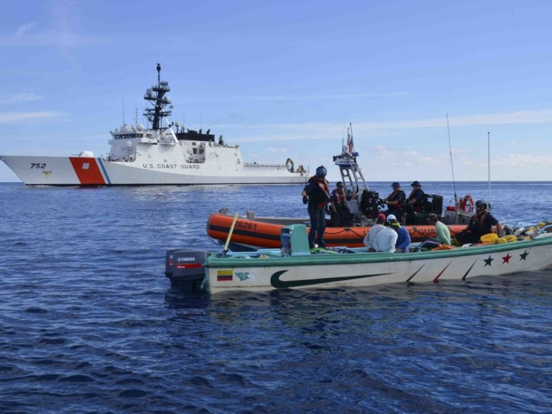 Boarding officers in an interceptor boat from the U.S. Coast Guard Cutter Stratton take suspected smugglers into custody in February. Courtesy USCG