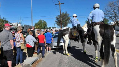 Mounted Sheriff's Department volunteers Chad Campbell and Scott Milner survey long lines outside Ramona Mainstage. Photo by Chris Stone