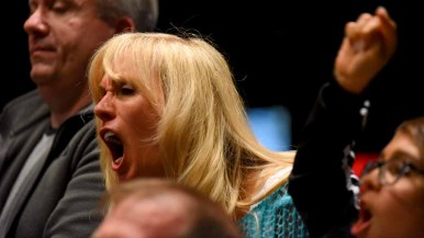 Sandra Cox of Temecula reacts angrily to a remark by Rep. Duncan D. Hunter. Photo by Chris Stone