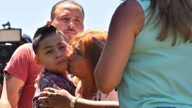Jessica Reyes Contreras (right) and her son Joseph spend a short time with her relatives in Mexico. Photo by Chris Stone