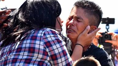 Lizbeth Borja Lopez and her son Rick Pernillo try to console Sonia Lopez Vasquez. Photo by Chris Stone