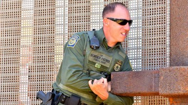Border Agents have to use some might to close the gate at Friendship Park. Photo by Chris Stone