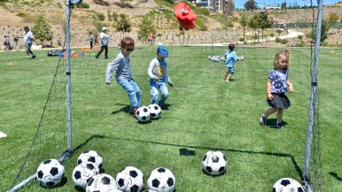 Children did soccer drills at the opening of Civita Park in Mission Valley. Photo by Chris Stone