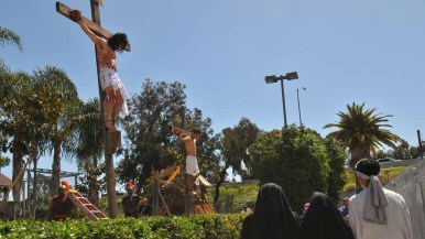 Actors re-enacted the crucifixion of Jesus Christ on Good Friday at Parishioners re-enact the crucifixion of Jesus Christ at Our Lady of Guadalupe Church. Photo by Chris Stone