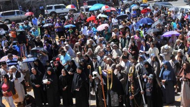 About 460 participants gathered at Our Lady of Guadalupe Church in Barrio Logan for the Good Friday re-enactment of Jesus' crucifixion. Photo by Chris Stone