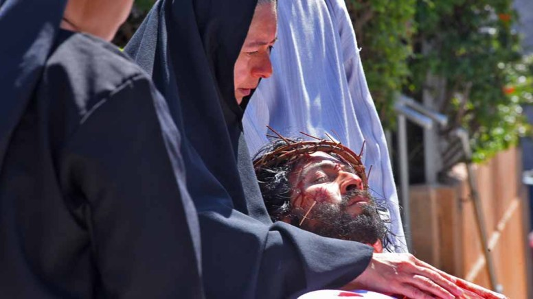 Mary cradles body of Jesus in re-enactment of crucifixion in Barrio Logan. Photo by Chris Stone