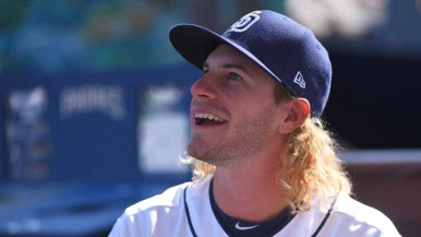 Padres outfielder Travis Jankowski listens to a fan during an autograph session at Padres FanFest. Photo by Chris Stone