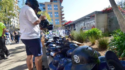 "At the Padres ""garage sale,"" fans check out used batting helmets. Photo by Chris Stone"