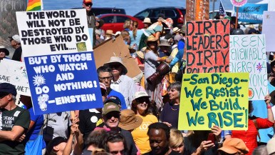 Creative signs at People's Climate March San Diego. Photo by Ken Stone