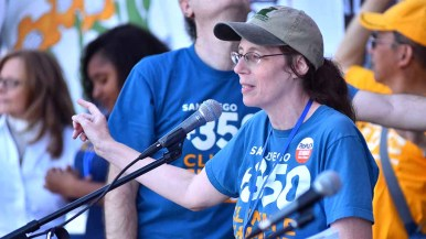 SanDiego350 founder Masada Disenhouse gives instructions before rally at People's Climate March San Diego. Photo by Ken Stone