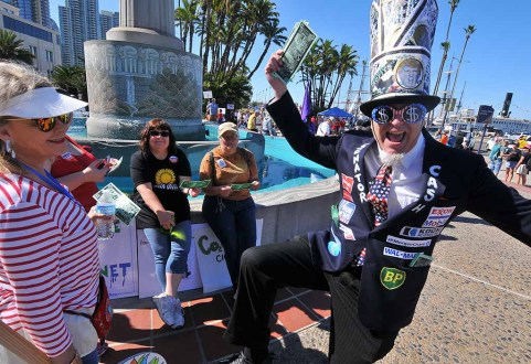 Michael Mufson, a theater professor at Palomar College, came dressed as Senator Cash, wearing logos of oil companies. Photo by Ken Stone