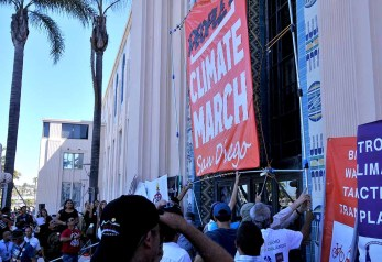 Black and white tape was used for People's Climate March San Diego sign, briefly displayed at rally before march. Photo by Ken Stone
