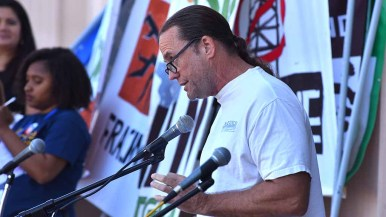 Jim Miller of the American Federation of Teachers exhorts crowd at People's Climate March San Diego. Photo by Ken Stone