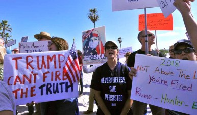 Protesters gathered outside the Hotel del Coronado, where the Republican National Committee Spring Meeting is being held. Photo by Chris Stone
