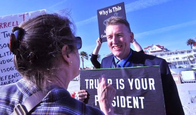 Steve Hardy of the Oceanside Citizens Coalition is confronted by an anti-Trump protester on the beach outside the Hotel del Coronado. Photo by Chris Stone