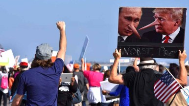 Protesters march along the beach by the Hotel del Coronado. Photo by Chris Stone