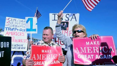 """Patti Siegmann (right) of the Oceanside Citizens Coalition shouts, """"We love Trump"""" in front of protesters. Photo by Chris Stone"""