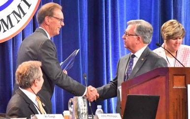 RNC general counsel Doyle Webb of Arkansas congratulates Jeff Kent (left) on election as Rules Committee chairman. Photo by Ken Stone