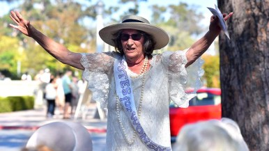 Judy Forman of the Big Kitchen leads the group in cheers at the annual suffragette rally and march in Balboa Park.