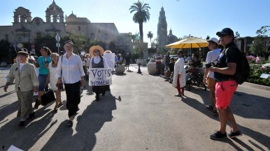 A group of 80 people, mostly women, participate in the annual suffragette march in Balboa Park.