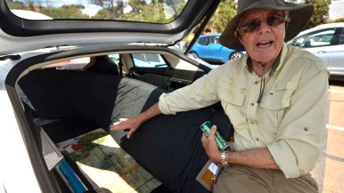 Coronado resident Craig Blasingame shows up his sleeping arrangement in his 2014 Tesla.