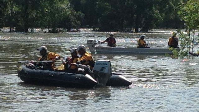 Rescuers on boats in Baytown, TX