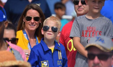 A son of a Blue Angel pilot watches the flight team perform at the Miramar Air Show.