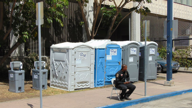 Portable toilets and hand washing stations near City Hall