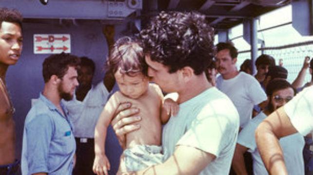 USS Kirk crewman with Vietnamese baby