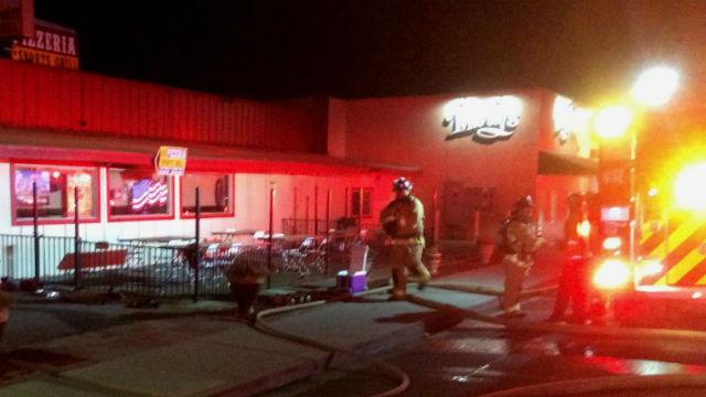 Firefighters outside Lakeside pizza restaurant