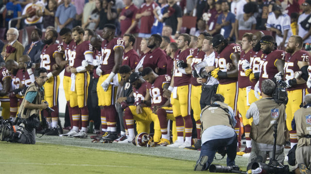 Washington Redskins team members kneel