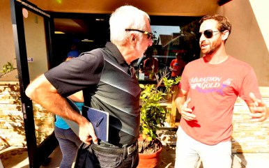 Eric Marenburg, co-founder of the event-management company High Performance Movement, chats with Vin Lananna after meeting.