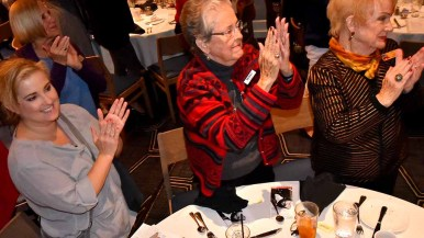 Members of the Navajo Republican Women's Club Federated applaud a presentation on Warrior Foundation Freedom Station.