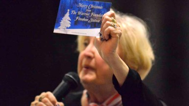 A Christmas card for the Warrior Foundation Freedom Station is displayed at club meeting.