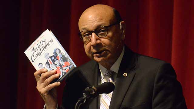 """Khizr Khan holds copy of his """"This Is Our Constitution,"""" written for middle-schoolers."""