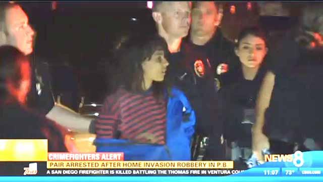Stephanie Majsterski (in stripes) is shown being arrested in November.