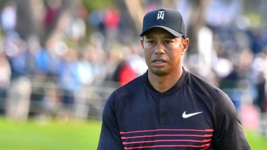 Tiger Woods kept a serious look in his latest PGA comeback.
