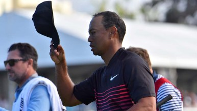 Tiger Woods doffs his cap after finishing play on the South Course.