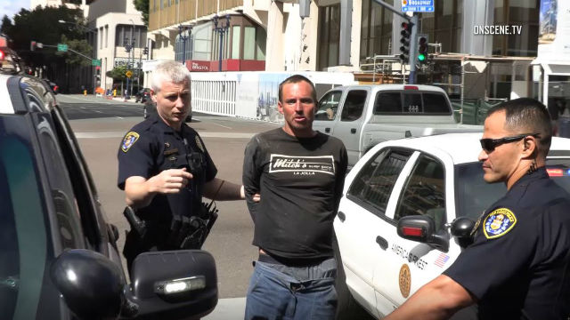Police with bank robbery suspect